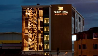 Sudima Auckland Airport exterior at night